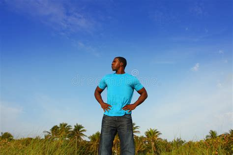 black tall standing l young black man standing tall royalty free stock photos