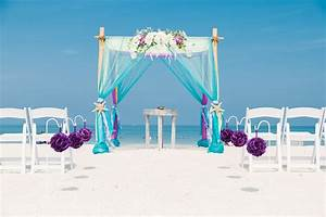 Colorful turquoise and purple beach wedding arbor.   Beach ...