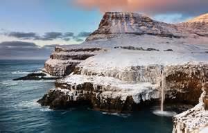 Waterfall in Gasadalur Village, Faroe Islands - Riveting Trip
