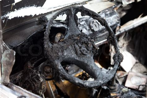 wreck accident fire burnt wheel car vehicle junk stock