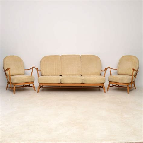 ercol settee second 1960 s vintage ercol sofa pair of armchairs