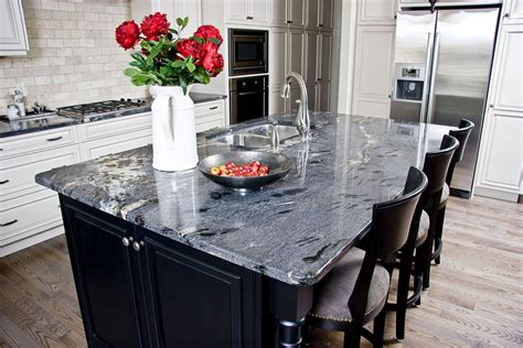 white kitchen island with black granite top granite countertops calgary quartz dauter inc 2217