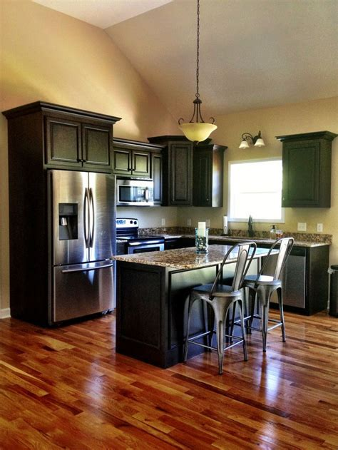 kitchen cabinets with wood floors black kitchen cabinets with wood floors