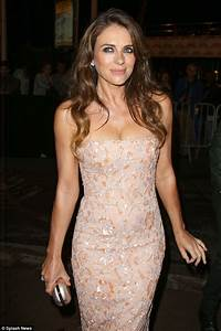 Elizabeth Hurley flashes her ample assets in boob tube ...