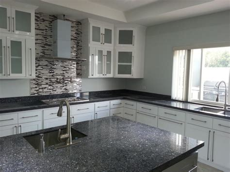 white harmony kitchen with blue pearl granite top