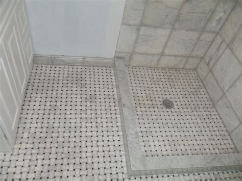 marble shower and basket weave floor
