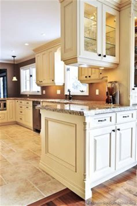 brown kitchen cabinets traditional antique white kitchen cabinets brown wall 6421