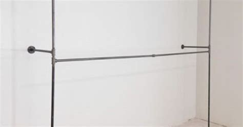 diy black iron industrial pipe closet rods for an