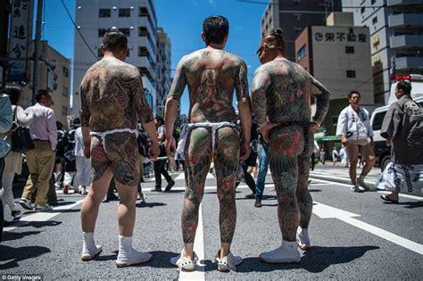yakuza tattoos  show  men  women hit  streets