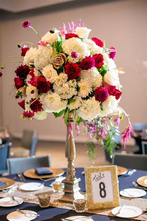 jewel toned tall flower centerpieces   austin hotel