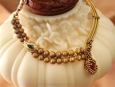 Antique Designer Necklace From Manubhai  South India Jewels. Floral Watches. Delicate Watches. Round Diamond Stud Earrings. Dark Blue Earrings. Cubic Zirconia Sapphire. Ladies Bangle Bracelet. Gaudy Earrings. Rose Gold Chains