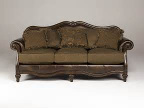 8430338 claremore antique faux leather sofa with fabric seat