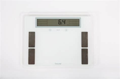 weighty decision  standing   bathroom scale