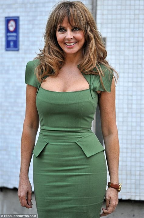 Carol Vorderman distracts from her new blonde 'do as she ...