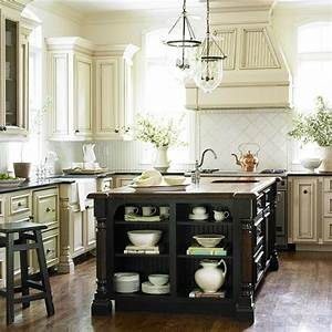 Cream wall cabinets with applied molding doors paired with for What kind of paint to use on kitchen cabinets for nature wall art decor