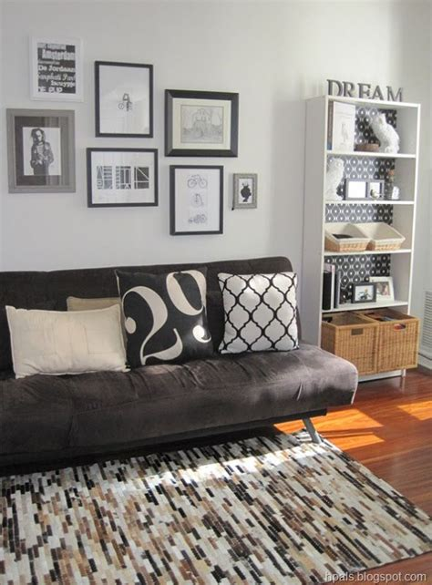 Living Room With Futon by Funky Studio But Would Be Cool For Cave Guest Room