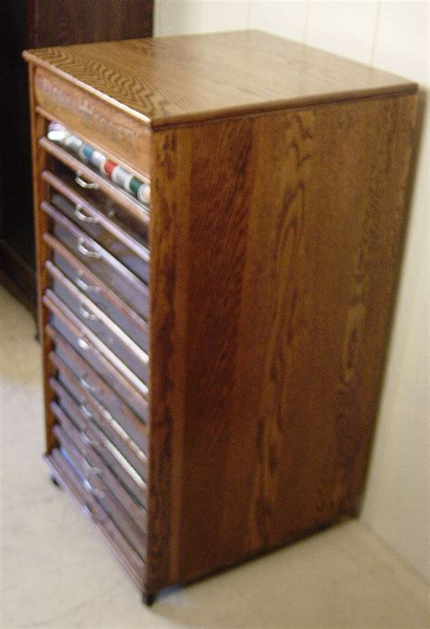royal society oak spool cabinet  glass front drawers