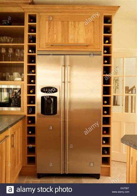 stainless steel fridge  built  wine rack storage  kitchen  stock photo alamy