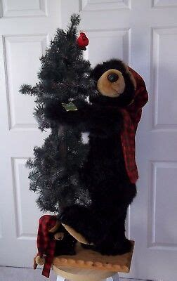 rare  dee  black bear cub hugging christmas tree