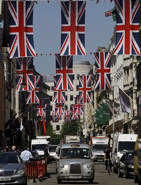 flying  flag britains streets  homes decked