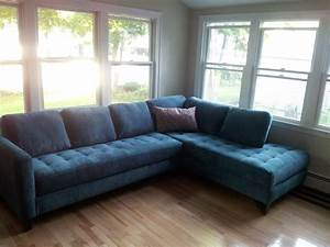 Dark Blue Tufted Sectional Sofa With Pillow And Black Wood