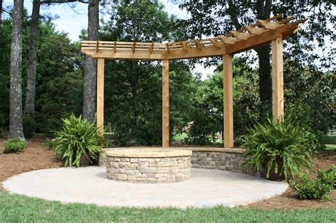 paver patio with pergola stacked firepit and