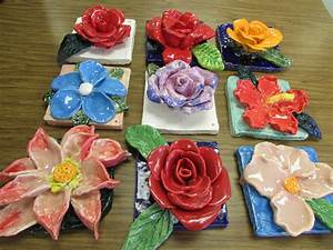 "Ceramic flower sculptures by 4th graders; approx. 7"" X 7 ..."