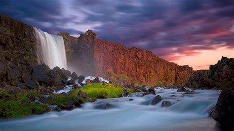 waterfall wall  red cliffs dark clouds hd wallpaper