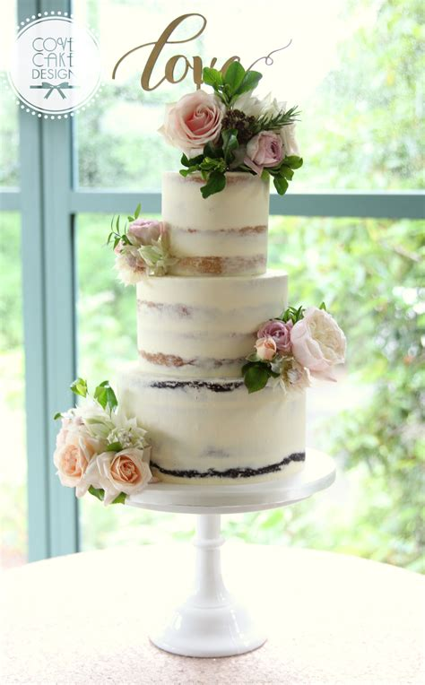 semi naked wedding cake  fresh flowers  love topper