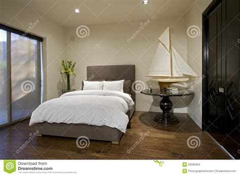 Bedroom With Boat Model On Side Table Stock Photo Image