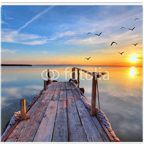 photo store enrouleur coucher de soleil sur la mer