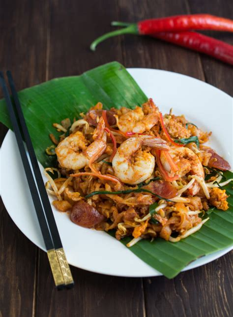 image may contain kitchen and penang char kway teow wok skillet