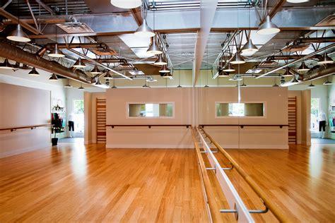 Fitness Studio. Ballet Bars, Bamboo Floors, Pendant Lights
