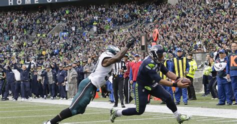 wilson throws catches leads seahawks  eagles