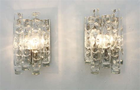 a decorative update with glass wall sconce light