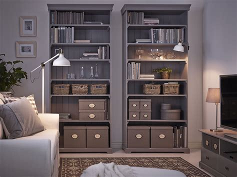 Baskets For Billy Bookcases by A Living Room With Two Grey Ikea Hemnes Bookcases Filled