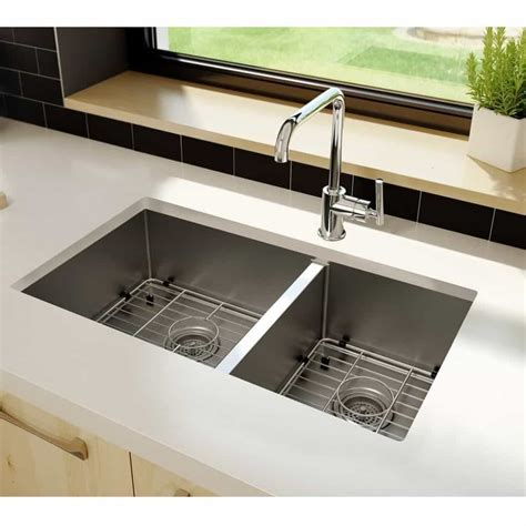 White Kitchen Sink With Stainless Steel Faucet by Stainless Steel Sink With White Countertops In The Kitchen