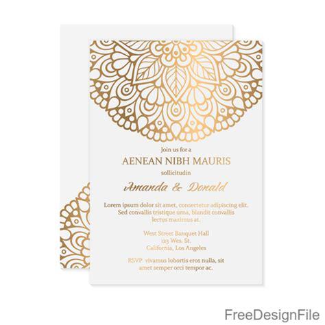 Golden decor ornaments with wedding invitation card