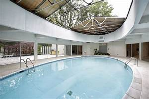 Suburban keck keck home with central pool retractable for Indoor pool with retractable roof