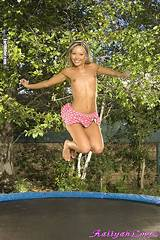 Naked girls jumping on the trampoline