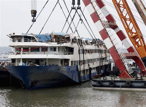 china blames weather for cruise ship disaster as charges