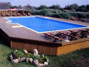 outdoor large above ground pool with deck above ground