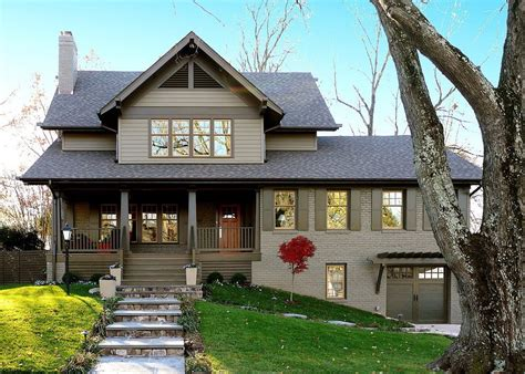 gray brick exterior exterior craftsman with raised porch