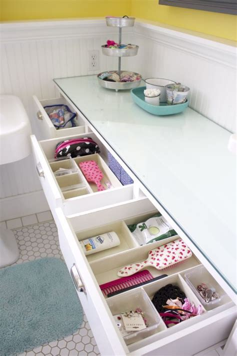 An Organized Kids' Bathroom Use Small Bins In Drawers To