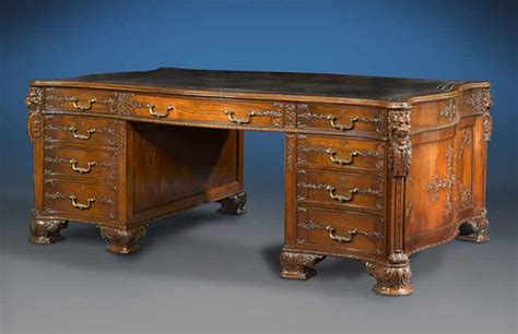 antique desk furniture is proving to be popular at auction houses