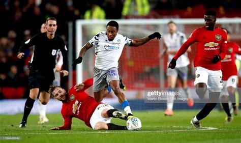 Manchester United's Luke Shaw slides in on Colchester ...
