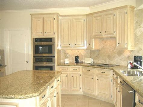 pickled oak cabinets  granite tops undermount stainless sink  stainless  black