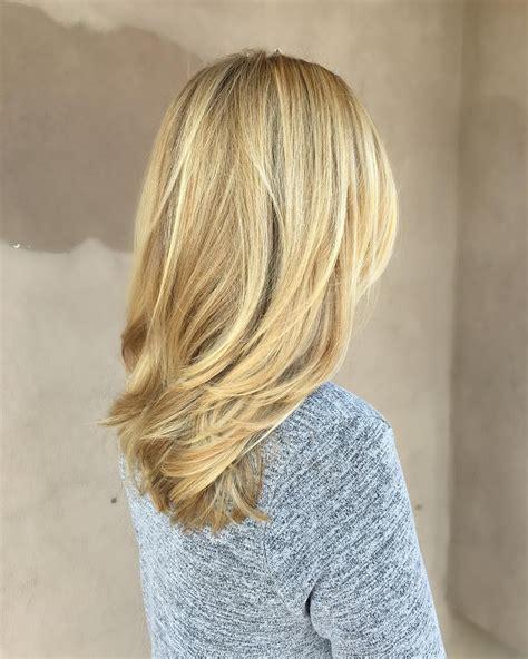medium length beige blonde straight hair  layers