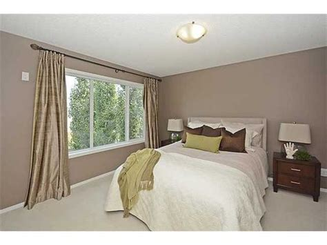 bedroom with the same color palette the mocha wall paint up the room for the home