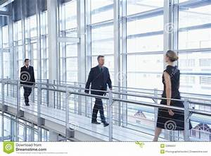 Business People Walking By Railing In Modern Office ...